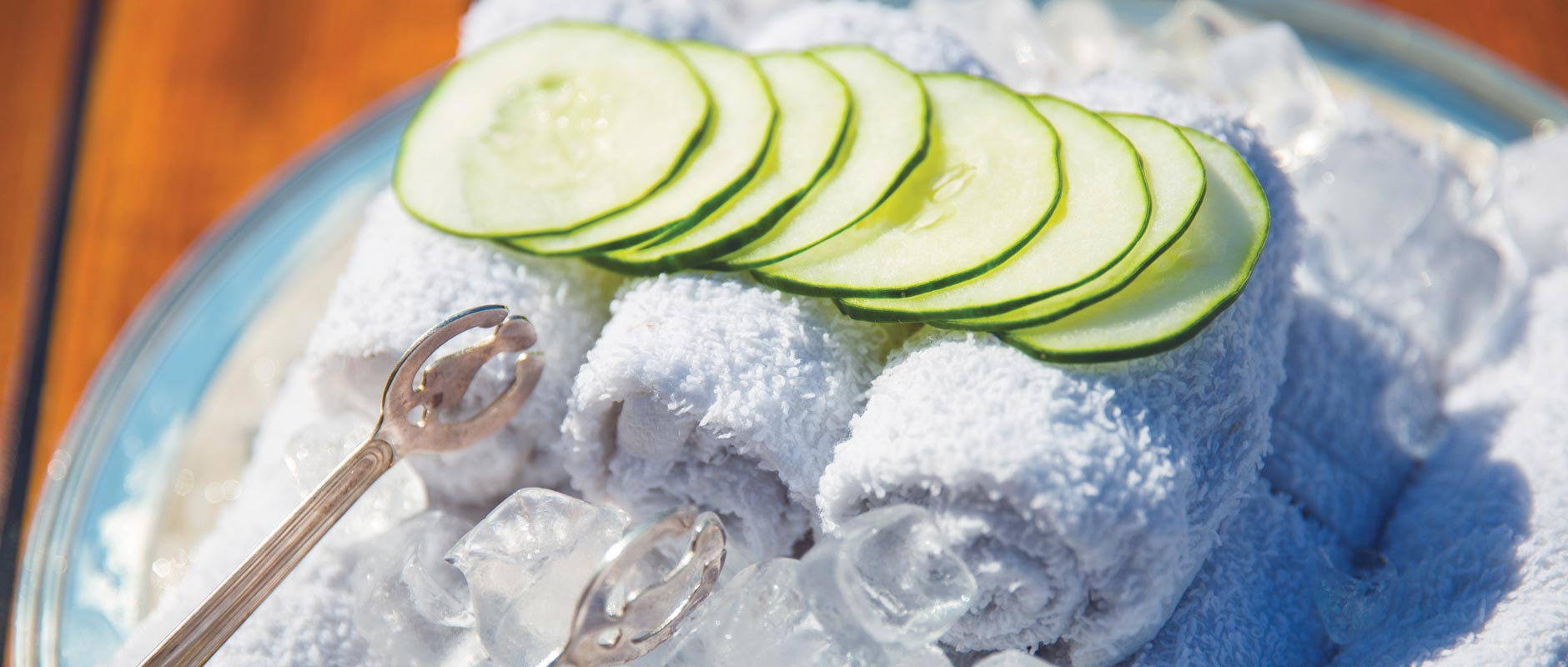 Chilled towels with cucumber slices over ice received on all all-inclusive cruises Seabourn